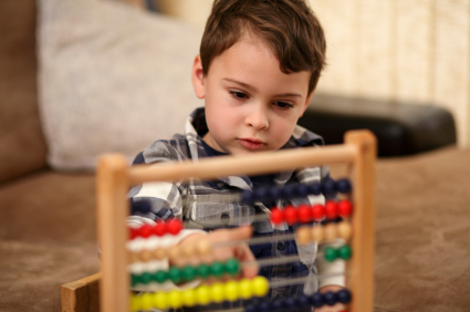 Child with autism playing with an abacus