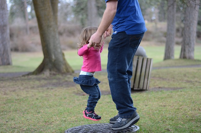 Jumping Dad with daughter
